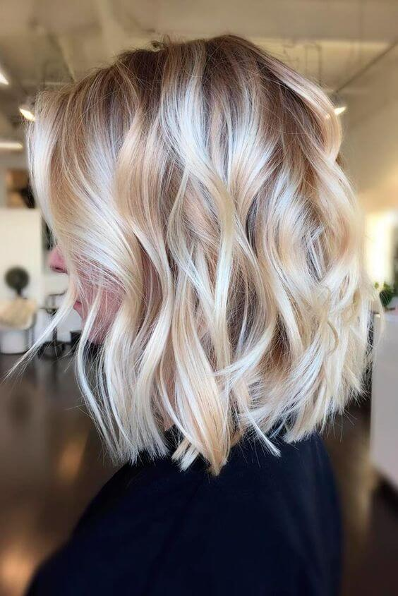 Tons of ash-blonde dimension in this shoulder length do