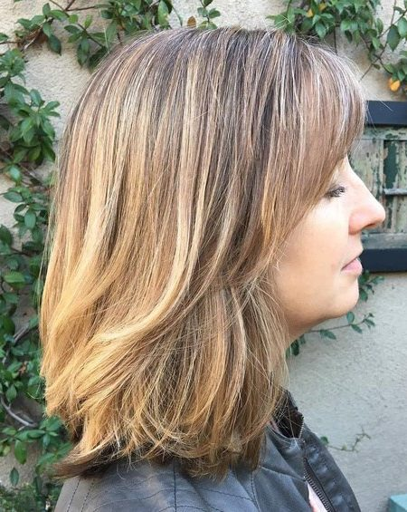 Medium length haircut with bangs