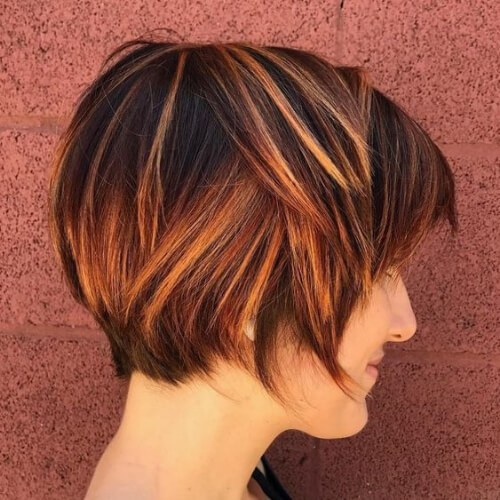 short copper hair with highlights