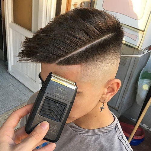 Skin fade + comb over + hard part