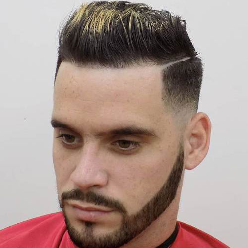 Low taper fade with hard part and brush