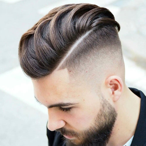 High bare fade with smooth back and beard