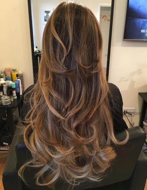 long layered hair in springy curls