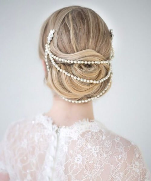 Bun draped in pearl headpiece wedding hairstyles for long hair