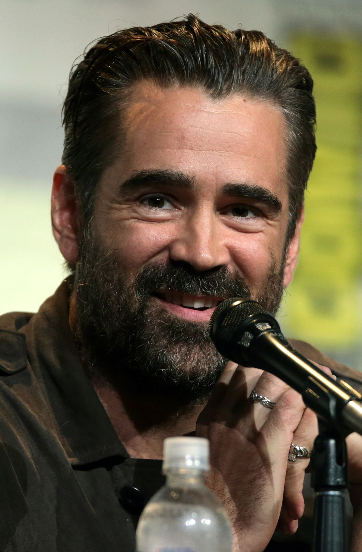 Colin Farrell smoothed out bakc hairstyles with beard for men in 2018