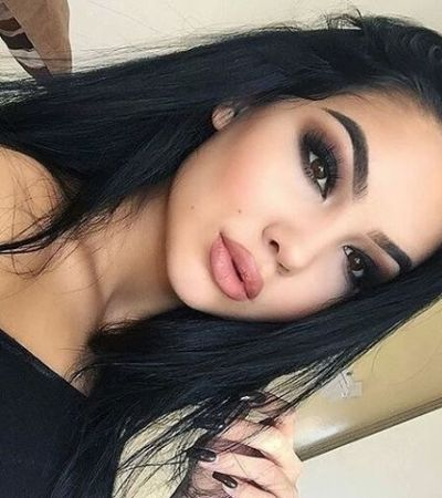 Natural black hairstyle with brown eyes