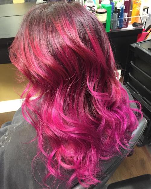 wavy hair with pink reflections