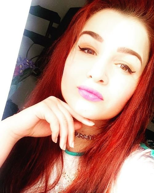 brown eyes with red hair color