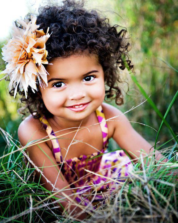 black girl curly hairstyles and a flower