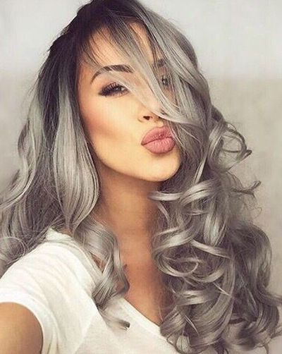 Salt and pepper gray on a large wavy hairstyle