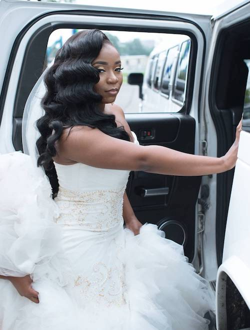 Black bride with long wavy hairstyle