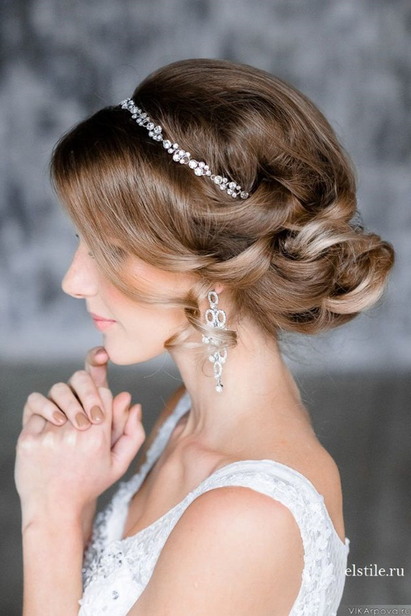 elegant updo wedding hairstyles-with-crystal bridal headdress
