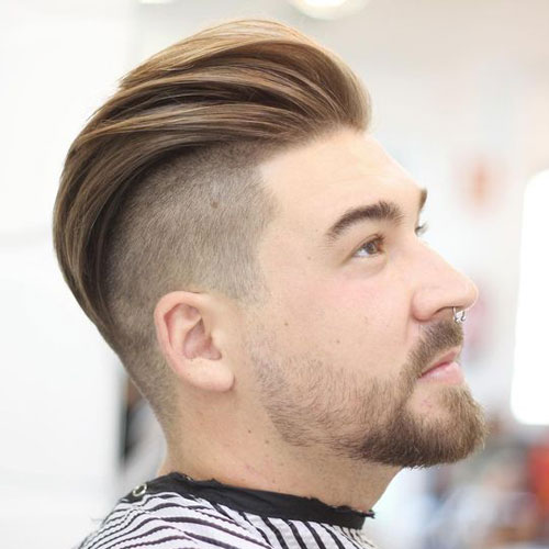 Textured slick back undercut hairstyle for men