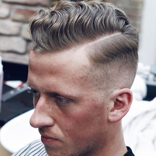 High fade + wavy hair comb over + part