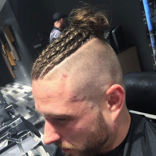 Braided man roll with shaved sides