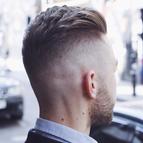 Cool textured back slit hair with interrupted undercut