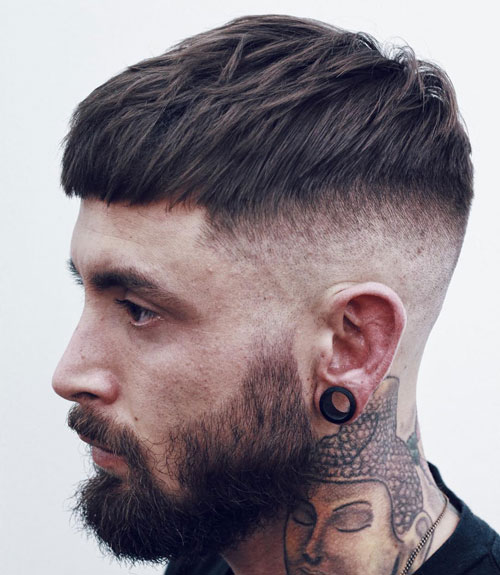 Cool modern haircuts for men - Short French crop with a high bald head and beard