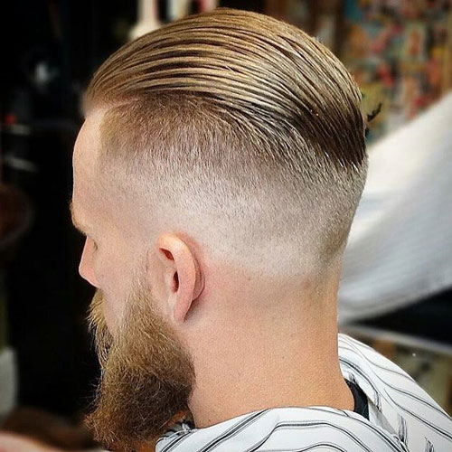 Slicked undercut with a thick beard