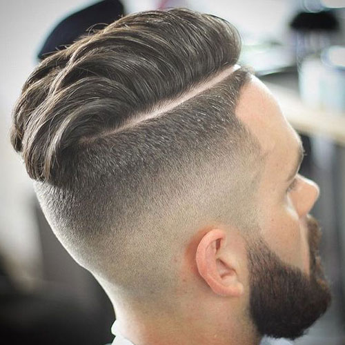 Thick, textured, straight back hair with full beard